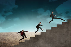 Business team race to the top stair Royalty Free Stock Photography