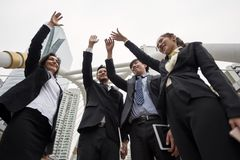 business team raise hands. project complete royalty free stock image