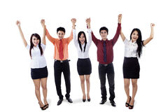 Business team raised hands in victory Royalty Free Stock Photos