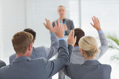 Business team raising hands during conference Stock Photos
