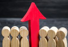 Business team and red up arrow between employees. The concept of a startup. Successful business growth. Qualification and royalty free stock image
