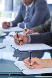 Business team redacting contracts Stock Photography
