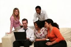 Business Team - relaxed meeting. Image of young business people viewing a presentation on a laptop royalty free stock image