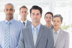 Business team relaxing eyes closed Stock Images