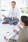 Business team relaxing eyes closed Royalty Free Stock Photography