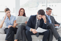 Business team reviewing work notes Stock Image