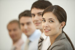 Business team in a row. Smiling business team in a row smiling three men one woman royalty free stock images