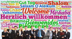 Business team saying welcome in many languages Stock Photo