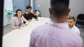 Business team with scheme at presentation. Teamwork, corporate and people concept - business team with scheme on flipboard at presentation in office stock footage