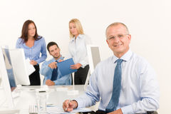 Business team senior manager with work colleagues Royalty Free Stock Photo