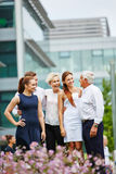 Business team with senior SEO outdoors Stock Images