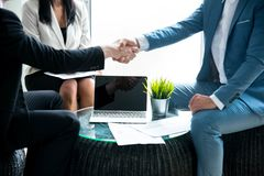 Business team shaking hand. S.finishing up a meeting stock photos