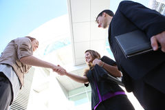 Business Team Shaking Hands. Attractive man and woman business team shaking hands stock photos
