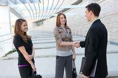 Business Team Shaking Hands. Attractive man and woman business team shaking hands stock image