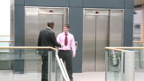 Business team shaking hands in a building Stock Photos
