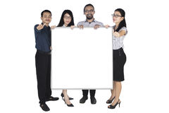 Business team showing billboard and thumbs up Stock Photography