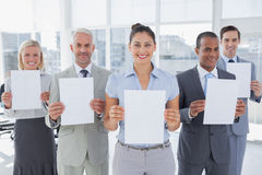 Business team showing blank pages Royalty Free Stock Photography