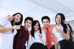 Business team showing OK sign in office Royalty Free Stock Images