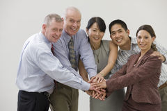 Business team showing solidarity Stock Image