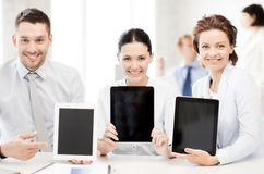 Business team showing tablet pcs in office Stock Photography