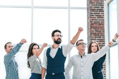 Business team showing their confidence in winning. Photo with copy space royalty free stock image