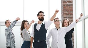 Business team showing their confidence in winning. Photo with copy space royalty free stock photography