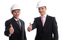 Business team, showing thumbs up. Isolated in white background royalty free stock photo