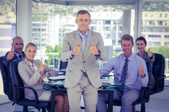 Business team showing thumbs up Stock Photo