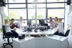 Business team showing thumbs up at office Stock Photos