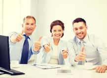 Business team showing thumbs up in office Stock Images