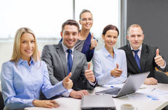 Business team showing thumbs up in office Royalty Free Stock Photography