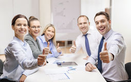 Business team showing thumbs up in office Royalty Free Stock Images