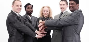 Business team showing union with their hands together forming a pile. Photo with copy space Royalty Free Stock Photography