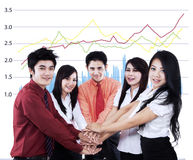 Business team showing unity Stock Images
