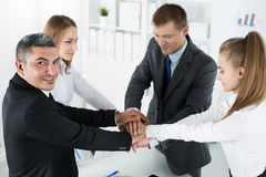 Business team showing unity with putting their hands together Royalty Free Stock Photography