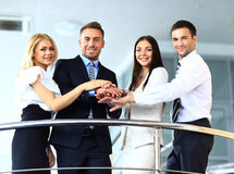 Business team showing unity with their hands Stock Photos