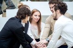 Business team showing unity with their hands together Royalty Free Stock Image