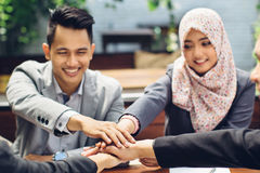 Business team showing unity with their hands together Stock Images