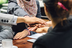 Business team showing unity with their hands together Royalty Free Stock Photo