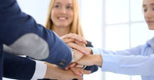 Business team showing unity with their hands together. Group of people joining hands and representing concept of royalty free stock photos