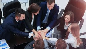 Business people with their hands together in a circle Royalty Free Stock Photos