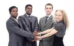 Business team shows its unity with hands clasped together. stock photography