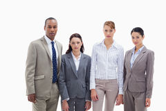 Business team side by side. Three women and one men against white background Stock Photos