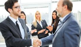 Business team with signed contract Stock Photos