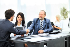 Business team with signed contract Stock Images