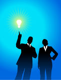 Business team silhouettes with light bulb Stock Photos