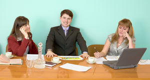 Business team sits at the table Stock Photo