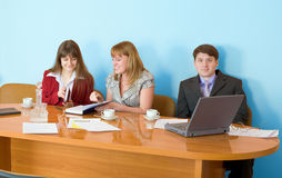 Business team sits at the table Royalty Free Stock Photo
