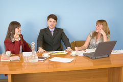 Business team sits at the table Royalty Free Stock Images