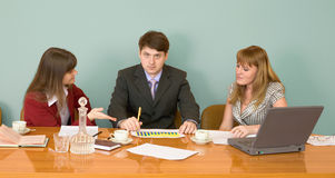 Business team sits at the table Stock Image